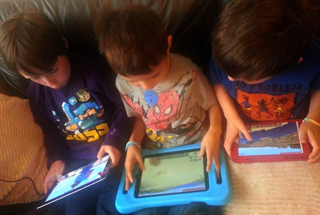 Three Boys using Tablets to Play Games