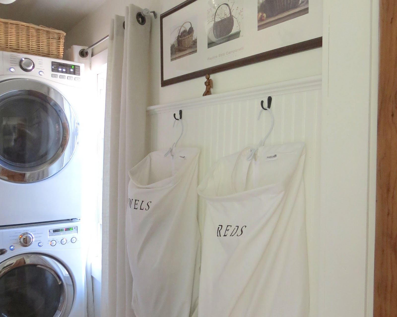 I found these laundry bags on Walmart.com and ordered 4. I stenciled the  words with a fabric pen and my husband hung the hooks. I LOVE this system  for this ...