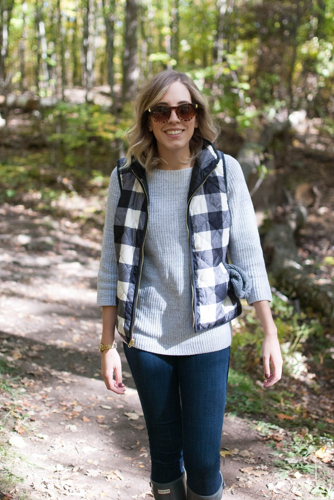 fall hiking outfit with quilted plaid vest