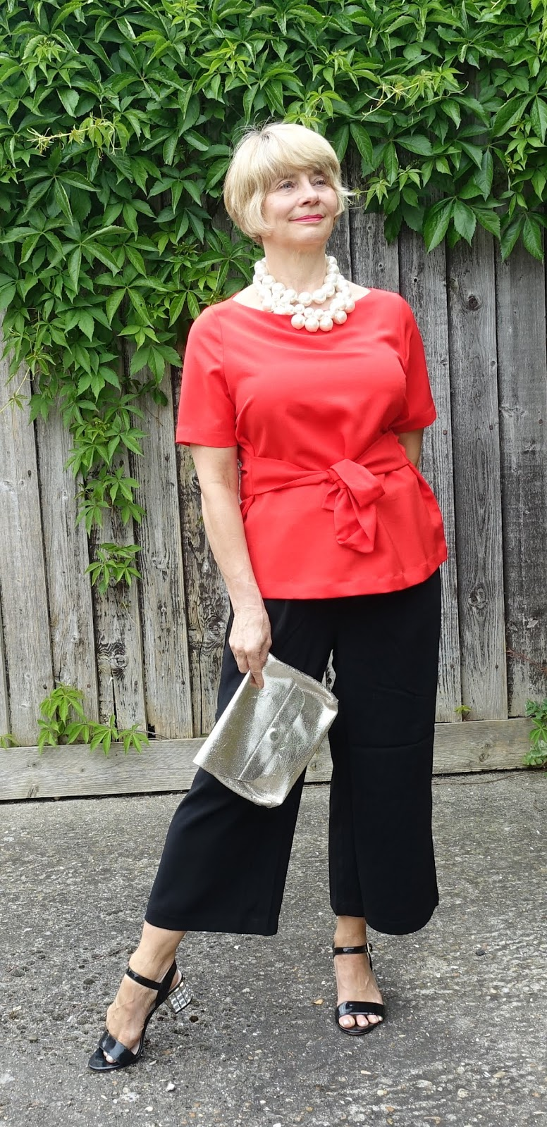 Is This Mutton? blog for the over-45s shows how to style wide black cropped trousers/pants for a work or evening look