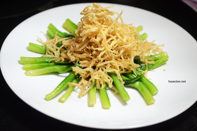 Stir-Fried Hong Kong Kailan Topped With Enoki Mushrooms
