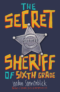 Book cover, 'The Secret Sheriff of Sixth Grade' by Jordan Sonnenblick. Cover image depicts a silver-colored, five-pointed star with the word 'Sheriff' embossed in the center against a dark blue background