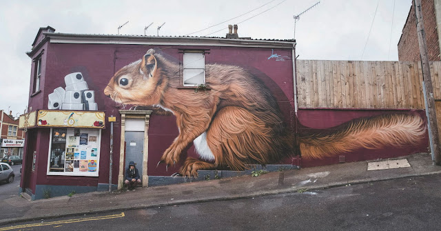 Lonac recently spent couple of days in Bristol, taking part at their 2015 edition of annual Upfest festival. Escaping the rainy weather he quickly worked his way on the scaffold finishing the beautiful mural just on time.