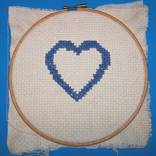Blue heart outline embroidered on monk's cloth