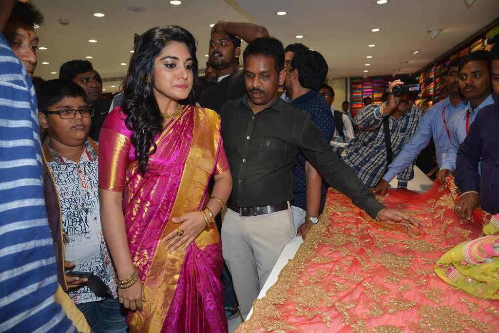 Niveda Thomas Hot Smiling Hip Photos In Traditional Red Saree At Store Launch