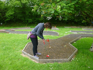 Minigolfer Emily Gottfried at the Crazy Golf course at the Thorne Park Golf Centre in Salcombe Regis, near Sidmouth, Devon