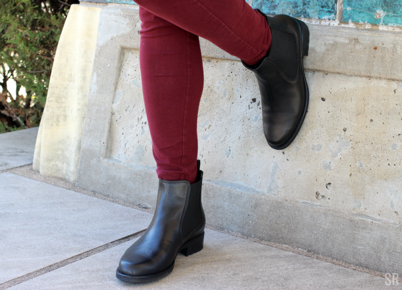 a woman posing in ankle boots