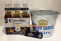 Logo In consegna Ice Bucket e bottiglie vinte con il concorso Corona