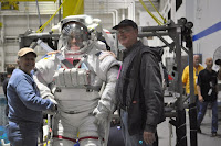 Chris and Betsy shaking hands with an astronaut