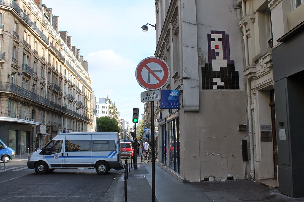 """Space Invader spent his night out on the streets of Paris, France working on this massive """"Mona Lisa"""" invasion."""