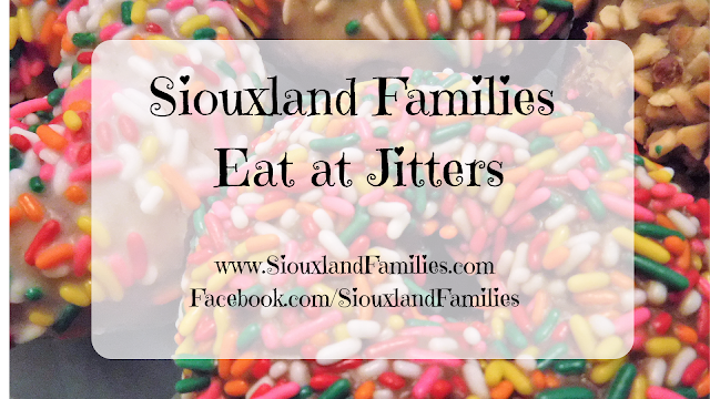 "in background, cake donuts topped with colorful sprinkles and with peanuts from Jitters in Sioux City, Iowa. In foreground, the title ""Siouxland Families Eat at Jitters"" and links to the Siouxland Families blog and Facebook page."