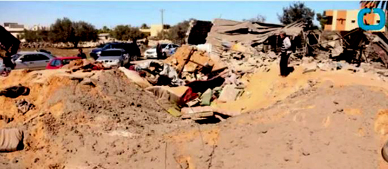"Crater where an ""ISIS-controlled"" building once stood in western Libya. (Screen capture from YouTube video.)"