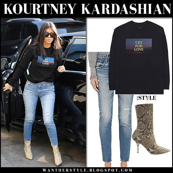 Kourtney Kardashian in black sweatshirt, jeans moussy and python boots yeezy street style december 6