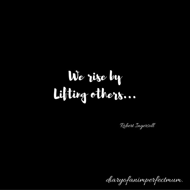 Text we rise my lifting others written in white in black background