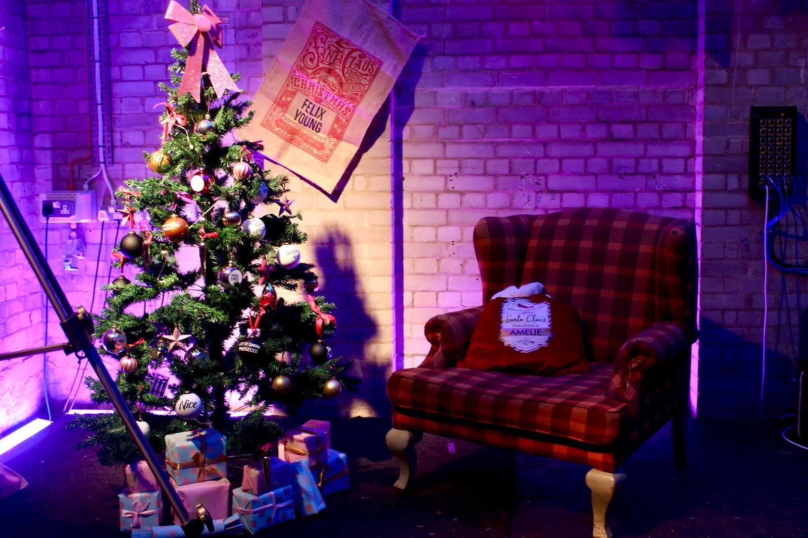 A christmas tree and lounge chair at the Prezzybox event