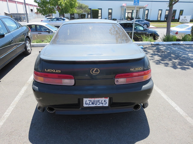 Faded Lexus SC300 in need of a complete paint job.