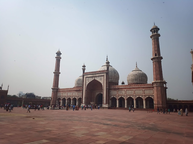 Jama Masjid building and courtyard with tourists and worshippers outside