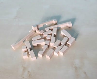 Morgan's Milieu | How Do You Train Your Brain?: A pile of wooden pieces from a wooden puzzle