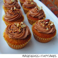 http://inaisst.blogspot.de/2013/08/haselnuss-cupcakes-mit-nutella-topping.html