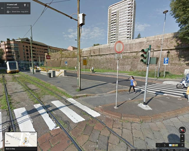 Porta Romana Metro Station underground entrance for the yellow M3 line with historical Spanish Wall in background of this Google Streetview