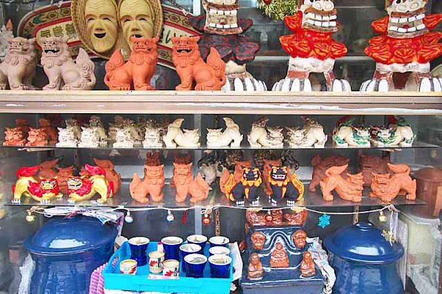 Various size and cloro shisa statues, pottery