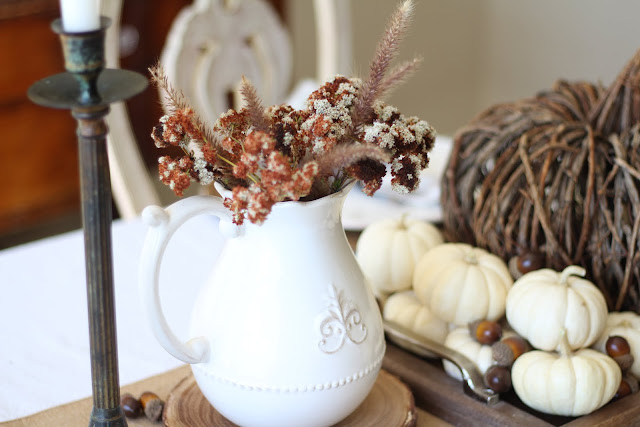 natural fall tablescape with white ironstone pitchers filled with fall wildflowers