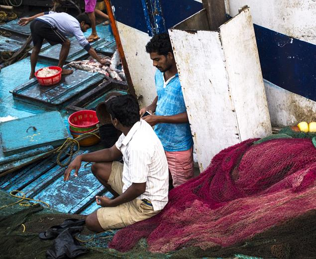 solitude fishermen fishing boat nets contemplating sassoon docks mumbai india