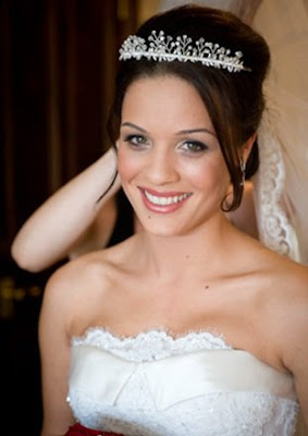 Stunning brunette bride with tiara and bangs