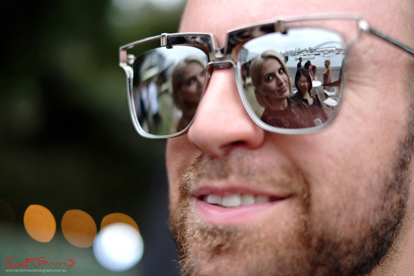 Christopher Haggerty, and reflected in his glasses Vanessa Roberts and Vivienne Shui, the Sydney Harbour Bridge! Windsor Smith Celebrates 70 years at #HarbourLife Sydney 2016. Photographed by Kent Johnson for Street Fashion Sydney.