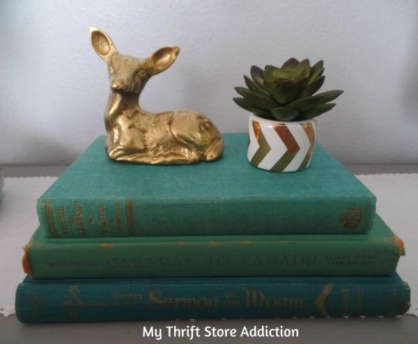 Napkin Ring Mini Succulent Pots  mythriftstoreaddiction.blogspot.com  Vintage books, thrift store deer and repurposed napkin ring succulent pots