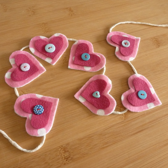 Pink felt hearts and button banner design