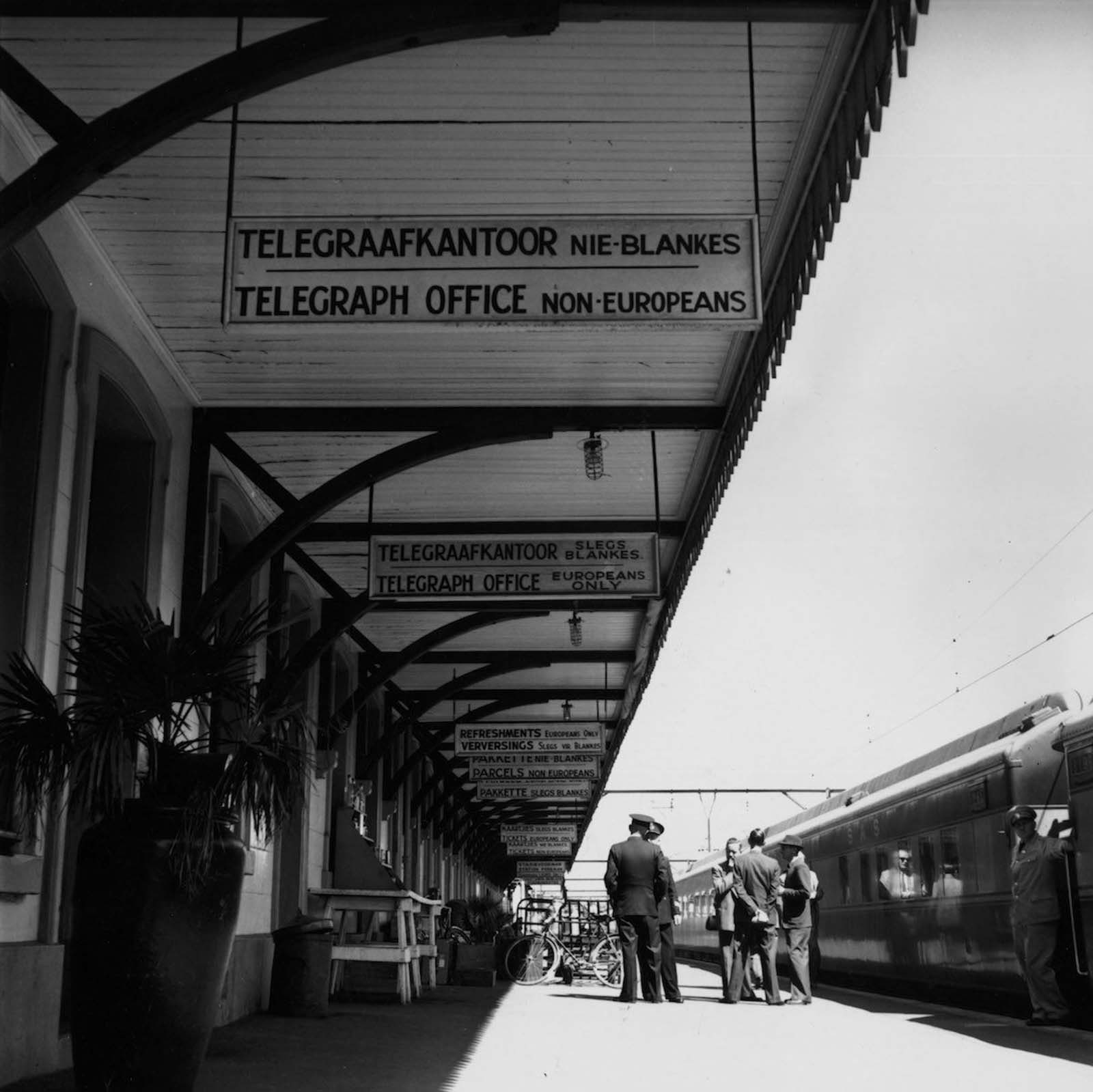 Signs in English and Afrikaans, in Wellington railway station, South Africa, enforcing the policy of apartheid or racial segregation. 1955.