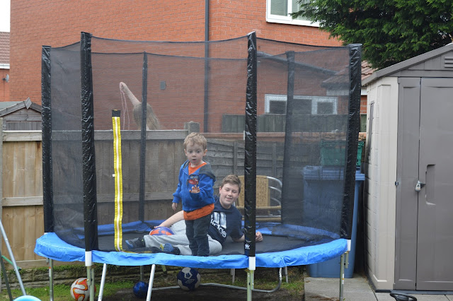 Boys playing on trampoline