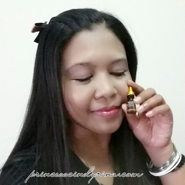 girl posing with ampoule