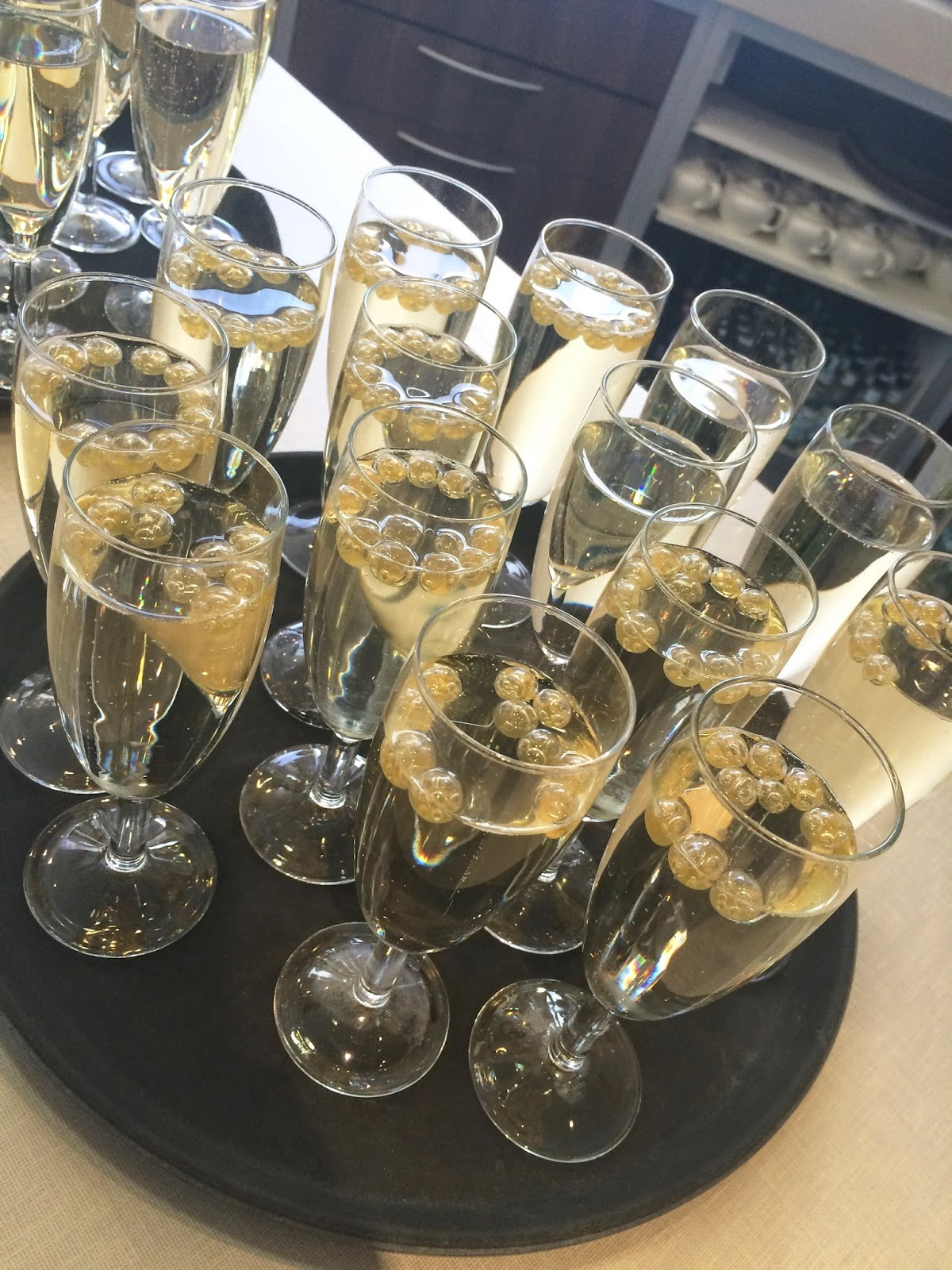 prosecco with passion fruit balls