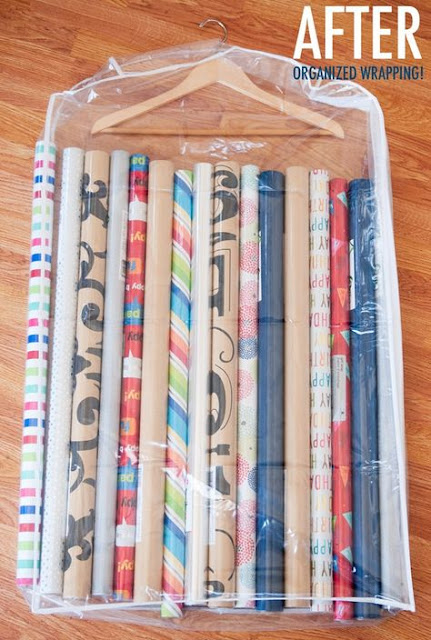 Organize  wrapping paper in a clear garment bag