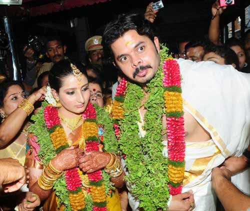 Sreesanth and Bhuvneshwari as bride and groom performing marriage rituals