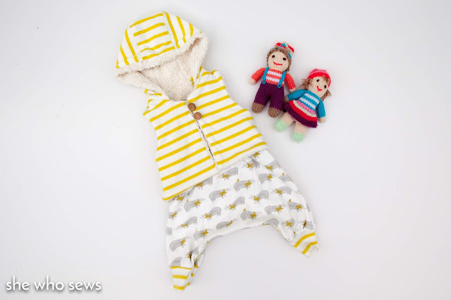 Yellow striped baby romper and knitted dolls