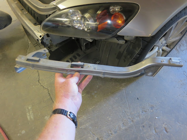 Replacing damaged bumper support bracket.