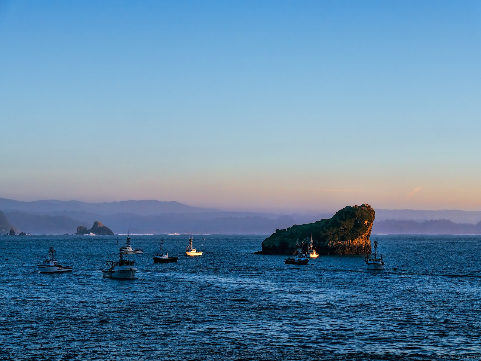 Large rock protecting fishing fleet