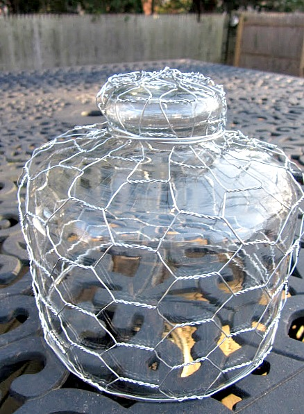 Glass lid covered with chicken wire