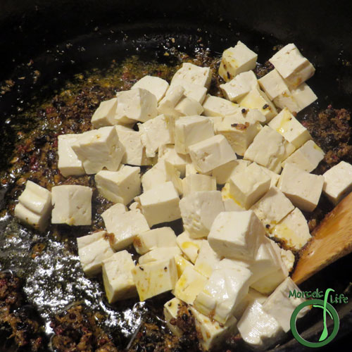 Morsels of Life - MaPo Tofu Step 6 - Toss in tofu, making sure it's cooked in the sauce.