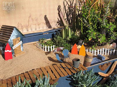 Succulent miniature garden beach scene in large chest