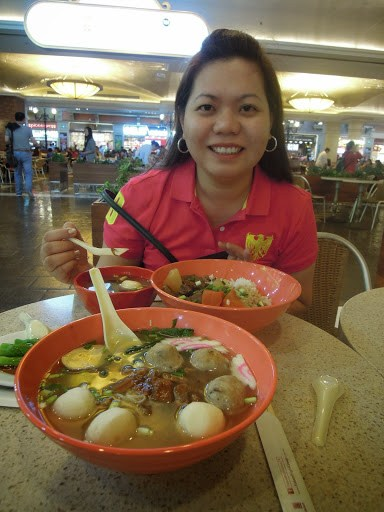 A travel blogger eating dumpling noodle soup for lunch at the food hall of The Venetian Hotel Macao