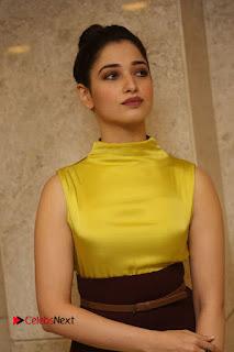 Actress Tamanna Stills in Yellow Dress at Okkadochadu Audio Launch  0088