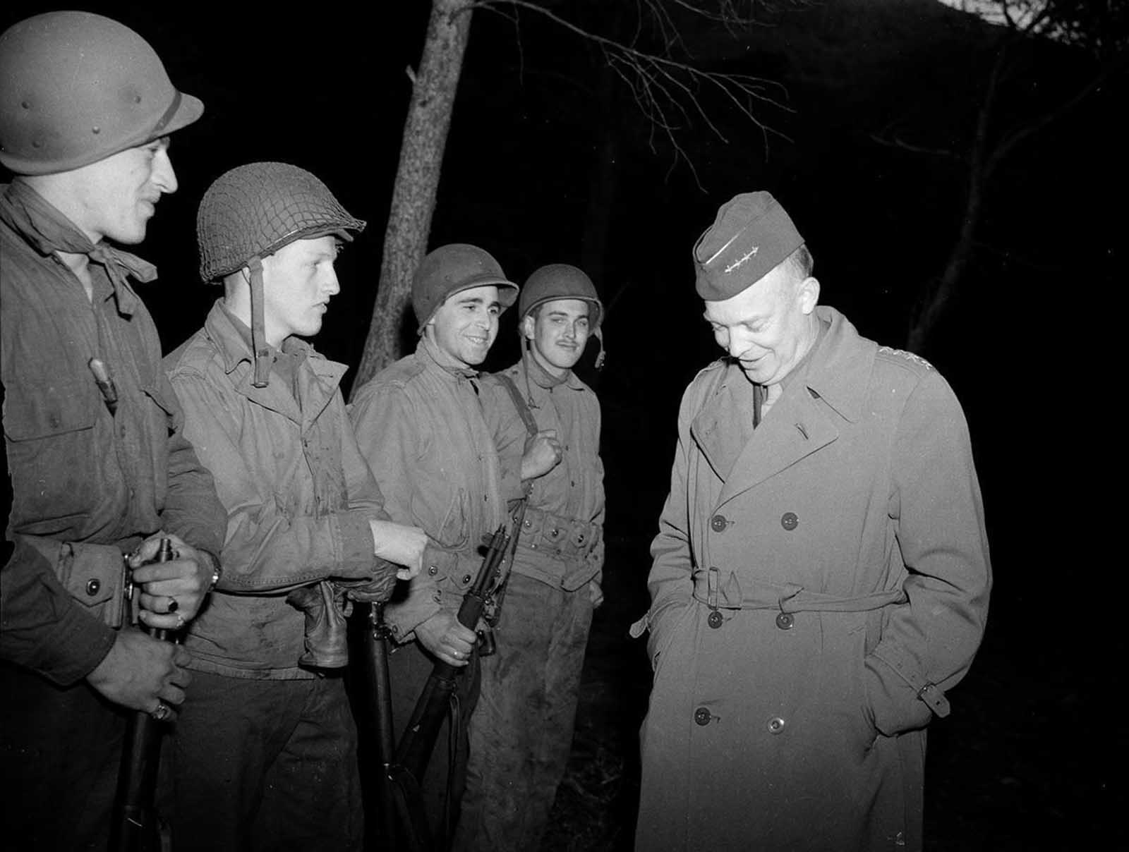 General Dwight D. Eisenhower, right, commander-in-chief in North Africa, jokes with four American soldiers during a recent inspection of the Tunisian battlefront, on March 18, 1943.