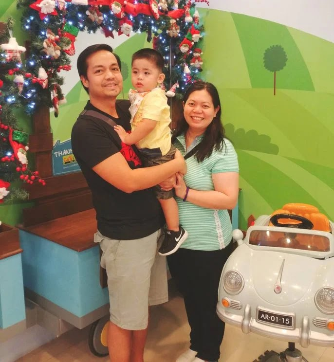 Happy family with baby in a toddler salon