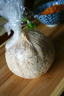 Perfect Fall Cheese Ball - Cheese ball mixture wrapped up in plastic wrap