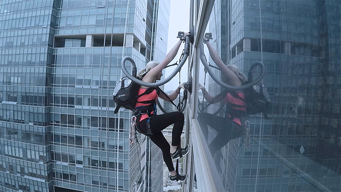Watch Sierra Blair-Coyle Climb This 460 Foot Skyscraper Using An LG CordZero Vacuum Cleaner