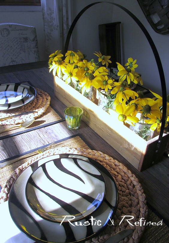 Easy and cheap centerpiece idea for a tablescape using zebra dishes and fresh flowers